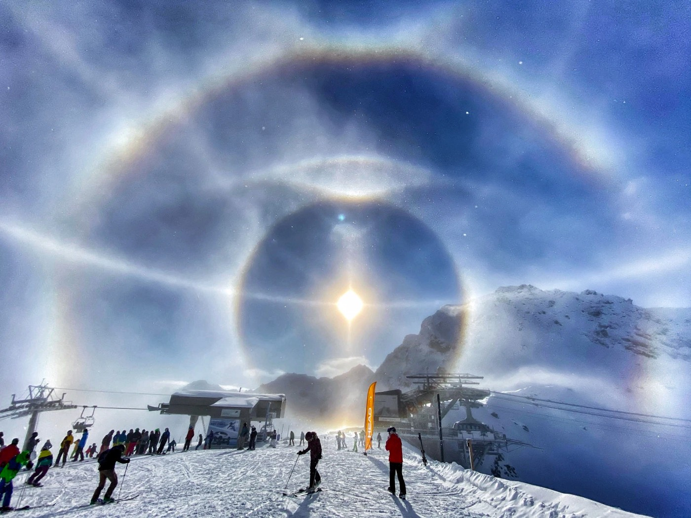 Incredible Display of Ice Crystal Halos Around the Sun in the Swiss Alps