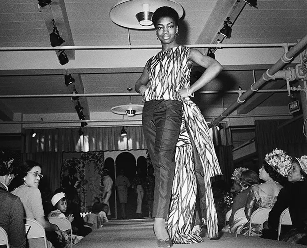 nomsa-brath-modeling-congolese-fabrics-sterns-department-store-1963-kwame-brathwaite-photo.png