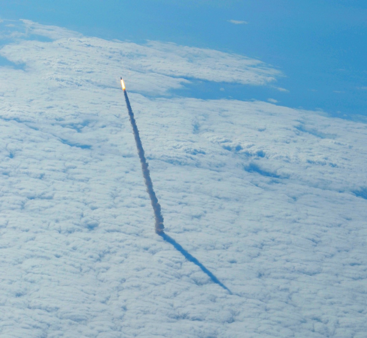 Shuttle Endeavour rising through the clouds